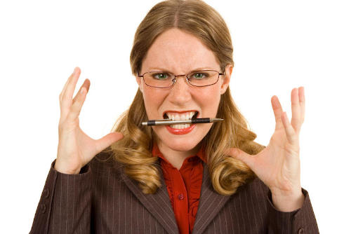 Angry boss with pen in mouth and hands up